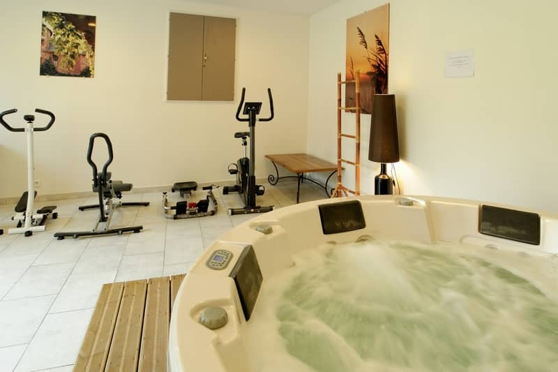 wellness area with fitness equipment and spa - character gites with swimming pool and charming bed and breakfasts near Carcassonne